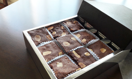 gusty: Chocolate brownies are not only favorite sweetmeat of people, it is also popular present to others in festival such as Christmas or New Year.  Because it has good packaging and it is yummy.
