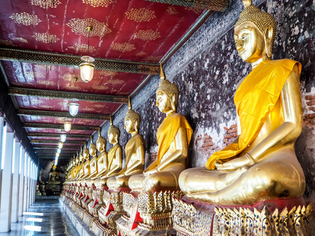 Golden Buddha images are in the attitude of meditation at Suthat Thepwararam temple�s corridor which is public property of Thailand.
