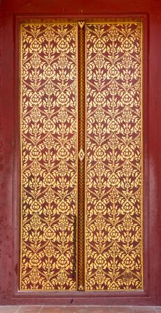 Thai style art painting on door of the temple