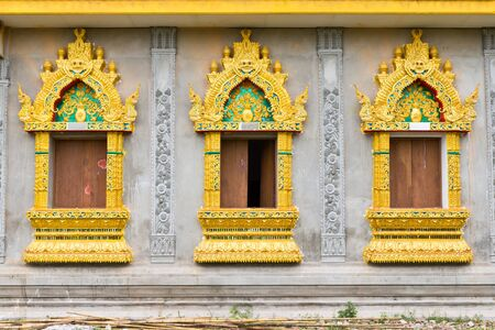 Ancient Golden carving wooden windows of Thai temple, thailand