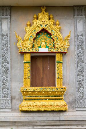 Ancient Golden carving wooden windows of Thai temple, thailand photo
