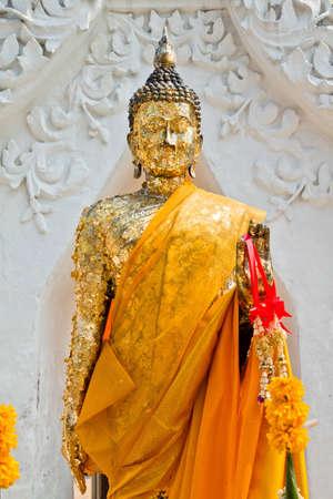 Golden standing Buddha statue Stock Photo