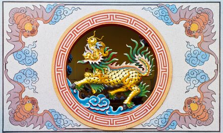 chinese dragon statue on chinese temple wall, Thailand