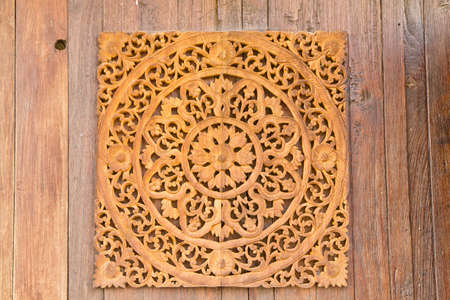 Pattern of flower carved on wood background Stock Photo - 12850135