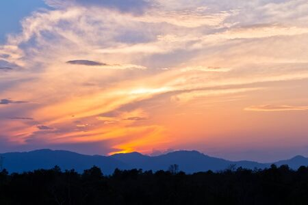 beautiful sunset behind the mountains