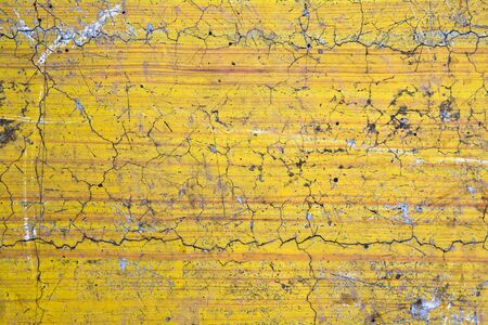 yellow Grunge cracked concrete wall Stock Photo