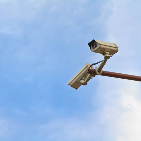 isolated surveillance cameras on the pole