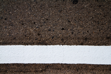 grey asphalt with white stripe