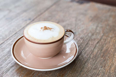 A cup of coffee on a wooden table Stock Photo