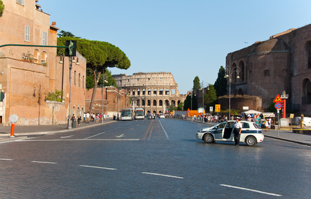 ROME-AUGUST 8  The Via dei Fori Imperiali on August 8,2013 in Rome, Italy  The Via dei Fori Imperiali is a road in the center of the city of Rome, that from the Piazza Venezia to the Colosseum