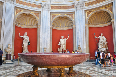Sala Rotonda with bronze sculpture of Herculeson in Pius-Clementine Museum on July 20,2010 in the Vatican, Rome, Italy