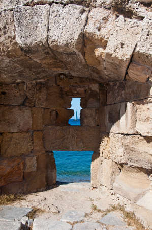 Medieval loophole in the old town on an island Rhodes, Greece  Stock Photo