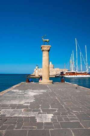 Mandraki harbor and bronze deer on Rhodes island, Greece  photo