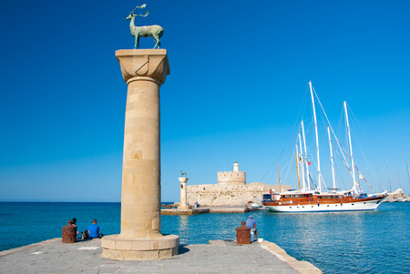 Mandraki harbor and bronze deer on Rhodes island, Greece