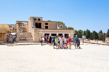 CRETE,GREECE-JULY 21  Tourists at the Knossos palace on July 21,2014 on the Crete island in Greece  Knossos is the largest Bronze Age archaeological site on Crete and is considered Europe s oldest city