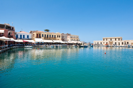 CRETE,RETHYMNO-JULY 23: The old venetian harbour with the various bars and restaurants in Rethymno city on July 23,2014. Crete island, Greece.