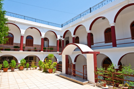 arched: Monastery of Panagia Kalyviani arched courtyard.Greece Stock Photo