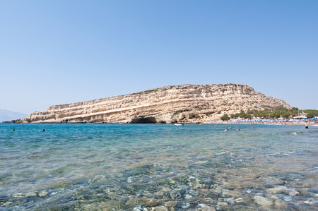 nudism: Libyan sea and the coast Matala sandy beach on the Crete island, Greece. Stock Photo