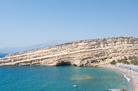 nudism: Famous Matala hippy beach with caves on the Crete island, Greece.