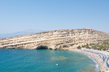 Famous Matala hippy beach with caves near Heraklion on the Crete island, Greece.
