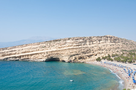 Famous Matala hippy beach with caves near Heraklion on the Crete island, Greece. photo