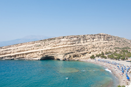nudism: Famous Matala hippy beach with caves near Heraklion on Crete, Greece. Stock Photo