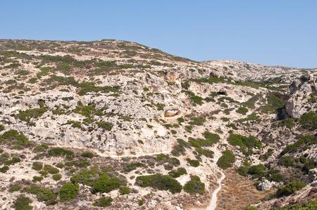 The way to the clothing-optional Red Beach near Matala beach on the Crete island, Greece.