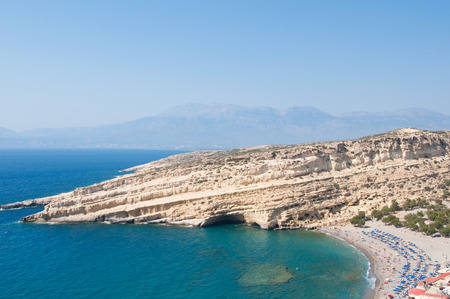 nudism: Panoramic view of Matala caves and Matala coast on the Crete island, Greece. Stock Photo
