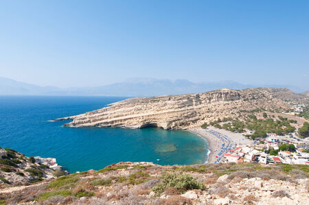 nudism: Panoramic image of Matala caves and Matala beach on Crete, Greece. Stock Photo
