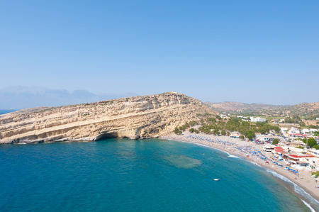 nudism: Panoramic image of Matala caves and Matala beach on the Crete island, Greece. Stock Photo