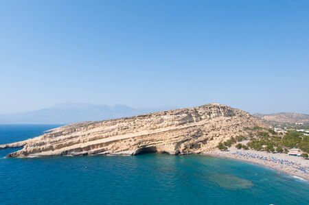 nudism: Panoramic view of Matala sandy beach and village on the island of Crete, Greece.