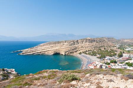 Panoramic view of Matala sandy beach and village near Heraklion on the island of Crete, Greece.