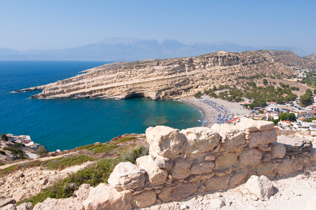 nudism: Panoramic view Beach of Matala seen the mountain near Heraklion town on Crete, Greece. Stock Photo