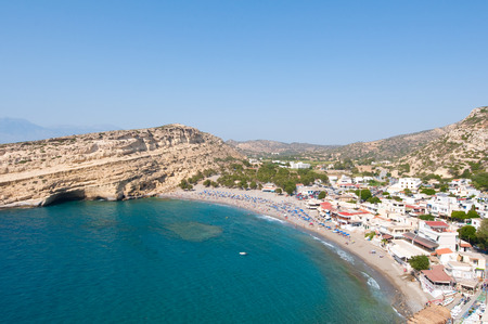 Panoramic view Beach of Matala with caves near Heraklion town on Crete, Greece.