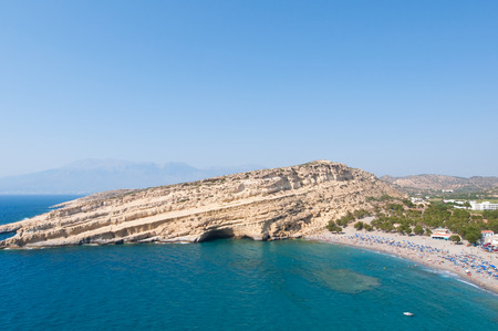 nudism: Panoramic view of Matala sandy beach with caves near Heraklion town on Crete, Greece Stock Photo