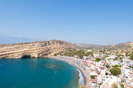 Panoramic view of Matala sandy beach with caves near Heraklion on Crete, Greece. Stock Photo
