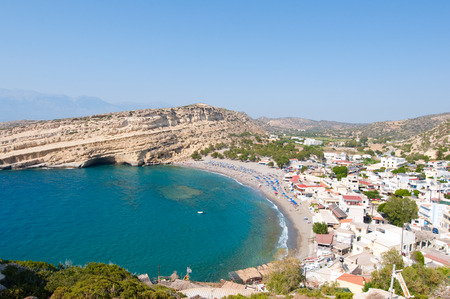 Panoramic view of Matala sandy beach with caves near Heraklion on the island of Crete, Greece.