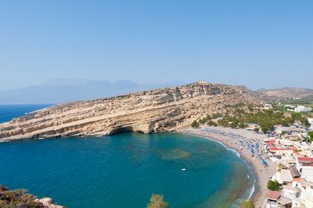 View of Matala sandy beach with caves near Heraklion on the island of Crete, Greece.