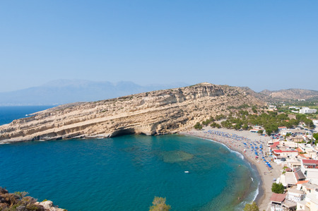nudism: View of Matala sandy beach with caves near Heraklion on the island of Crete, Greece.