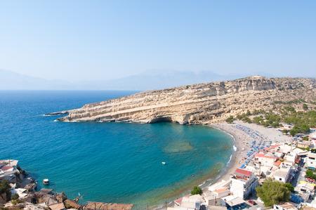 Matala sandy beach with caves near Heraklion on Crete, Greece. Stock Photo