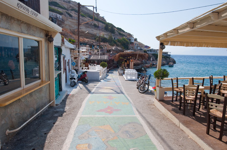 nudism: Colorful street in Matala village on July 22,2014 on the island of Crete, Greece.  Editorial
