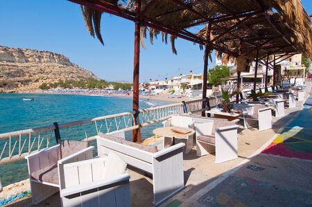 nudism: MATALA,CRETE-JULY 22: Local restaurant in Matala village on July 22,2014 on the island of Crete, Greece. Matala is a village located 75 km south-west of Heraklion, Crete.