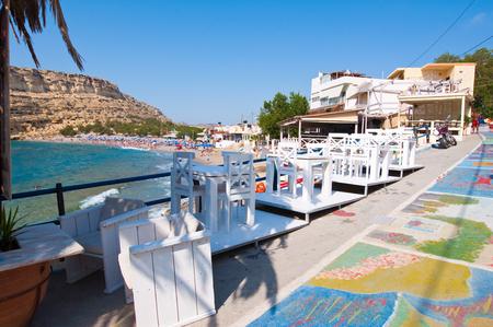 MATALA,CRETE-JULY 22: Matala street and coast on July 22,2014 on the island of Crete, Greece. Matala is a village located 75 km south-west of Heraklion, Crete. Editorial