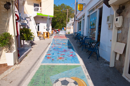nudism: MATALA,CRETE-JULY 22: Matala street on July 22,2014 on the island of Crete, Greece. Matala is a village located 75 km south-west of Heraklion, Crete. Editorial