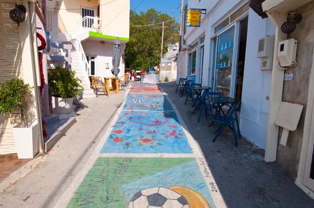 MATALA,CRETE-JULY 22: Matala street on July 22,2014 on the island of Crete, Greece. Matala is a village located 75 km south-west of Heraklion, Crete. Editorial