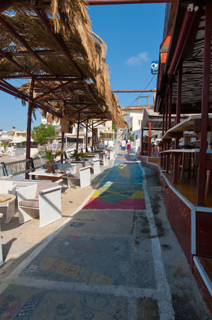 nudism: MATALA,CRETE-JULY 22: Colorful street in Matala village on July 22,2014 on the island of Crete, Greece. Matala is a village located 75 km south-west of Heraklion, Crete.