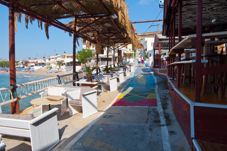 nudism: MATALA,CRETE-JULY 22: Colorful street and restaurant in Matala village on July 22,2014 on the island of Crete, Greece. Matala is a village located 75 km south-west of Heraklion, Crete.