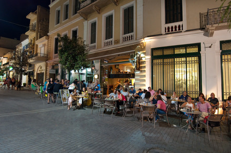 CRETE,HERAKLION-JULY 24: People in a  local restaurant next to Lions Square on July 24,2014 on the Cete island in Greece.