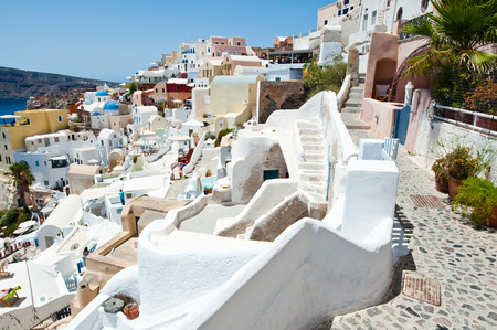 thera: Oia carved-in buildings on the island of Thera (Santorini), Greece.