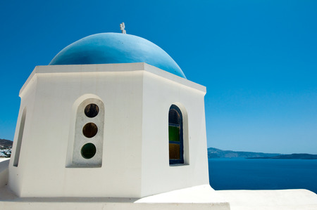 Detail of Oia church with blue cupola on the island of Thera (Santorini). The Cyclades, Greece. photo